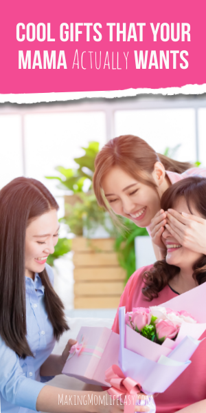 two black haired girls handing a gift to their mom and smiling