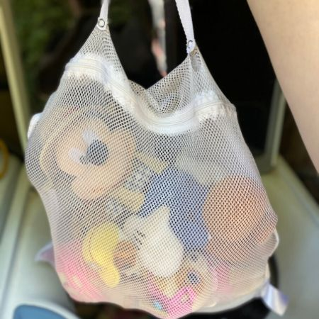 mesh bag full of stuffed animals