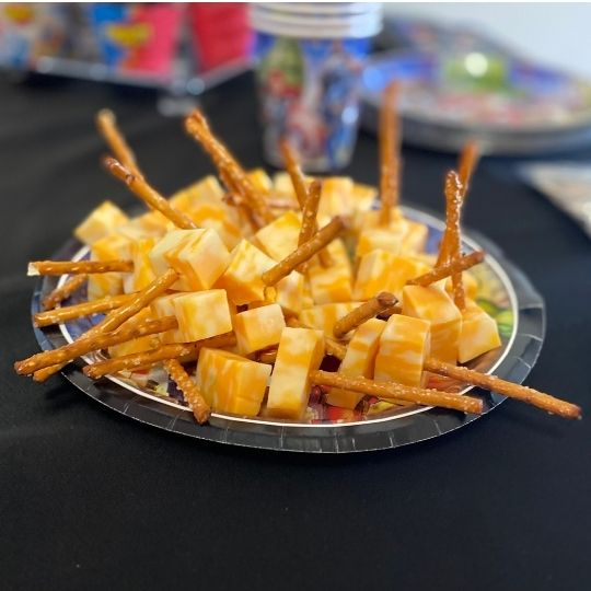 Picture of cheese and pretzel bites shaped like 'Thor hammers' for Avengers party